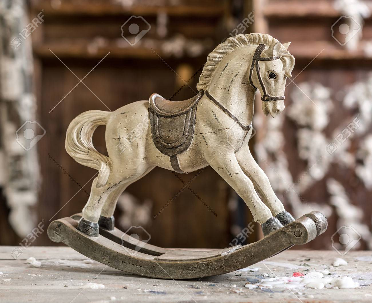 Vintage Old Rocking Horse On A Wooden Background Stock Photo Picture And Royalty Free Image Image 25968713