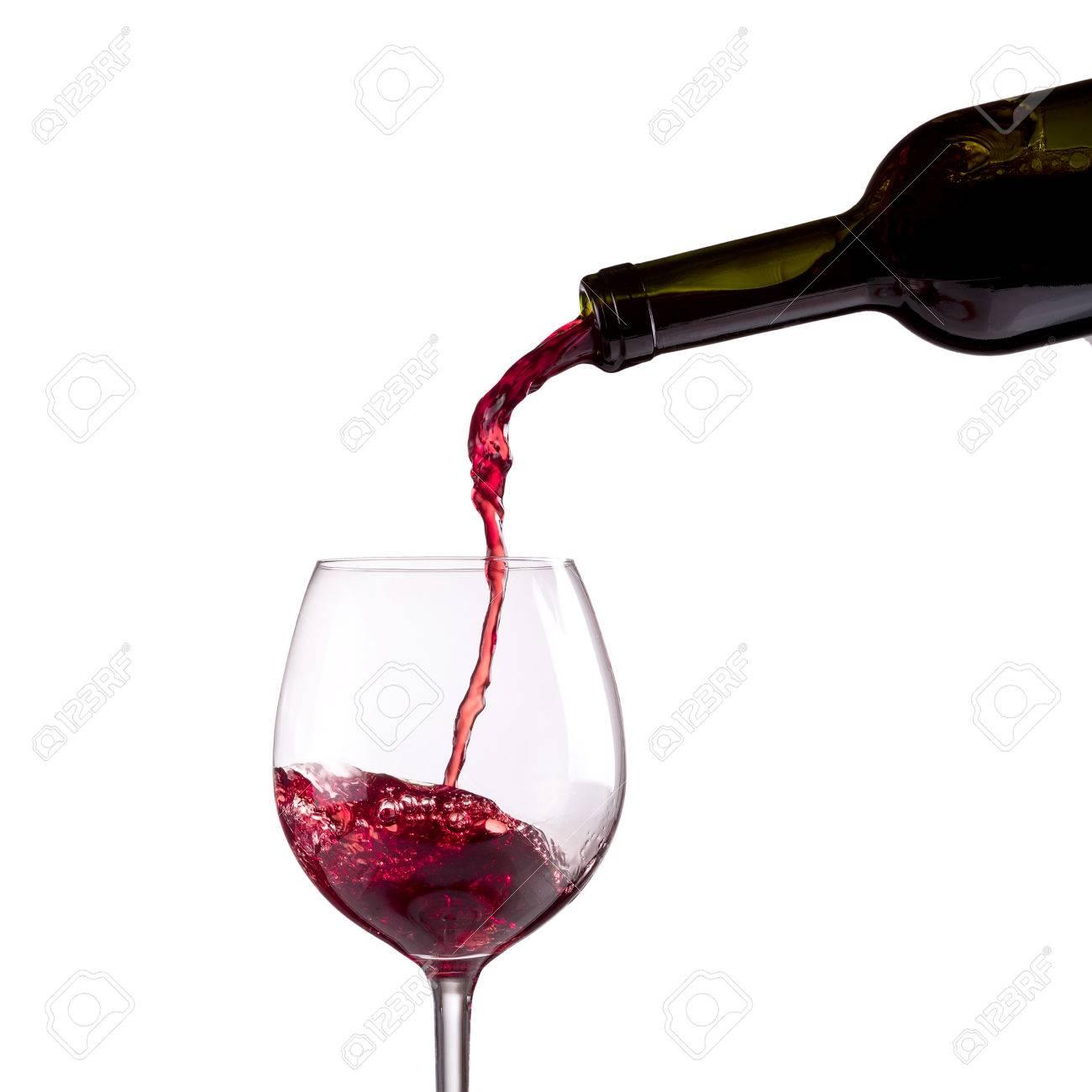 Immagini Stock Vino Rosso Che è Versato In Un Bicchiere Di Vino Su