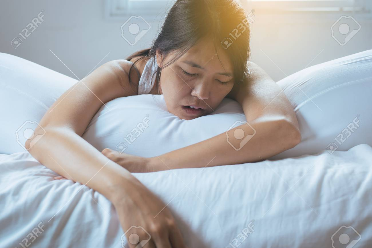 Asian Woman Snoring Because Due To Tired Of Work Female Snor Stock Photo Picture And Royalty Free Image Image 104789528