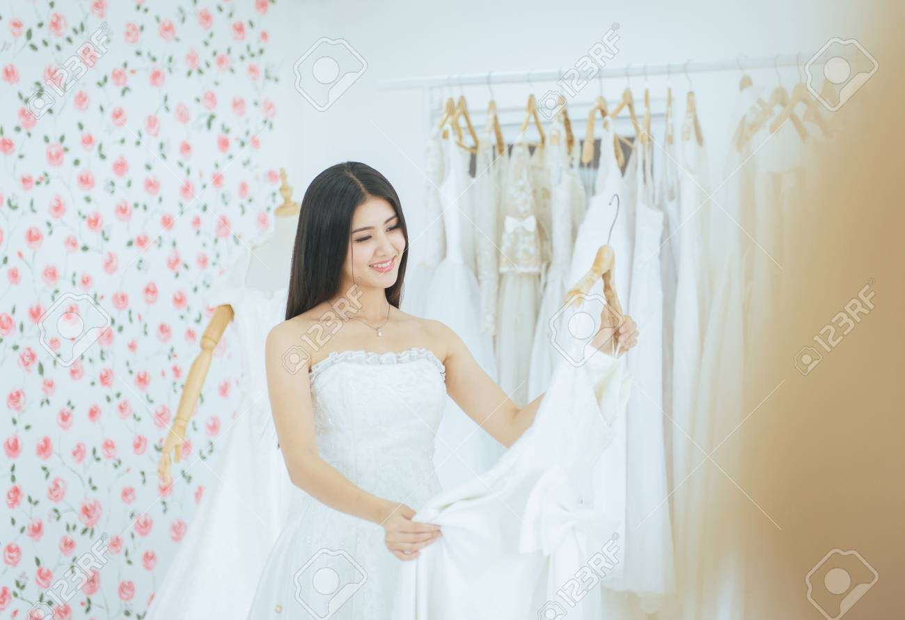 Asian Beautiful Woman Bride Trying On Wedding Dress Happy And