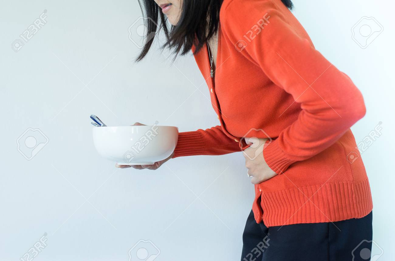 Digestion problems,Woman with stomach pain after eating,Hand female holding her belly - 113947008