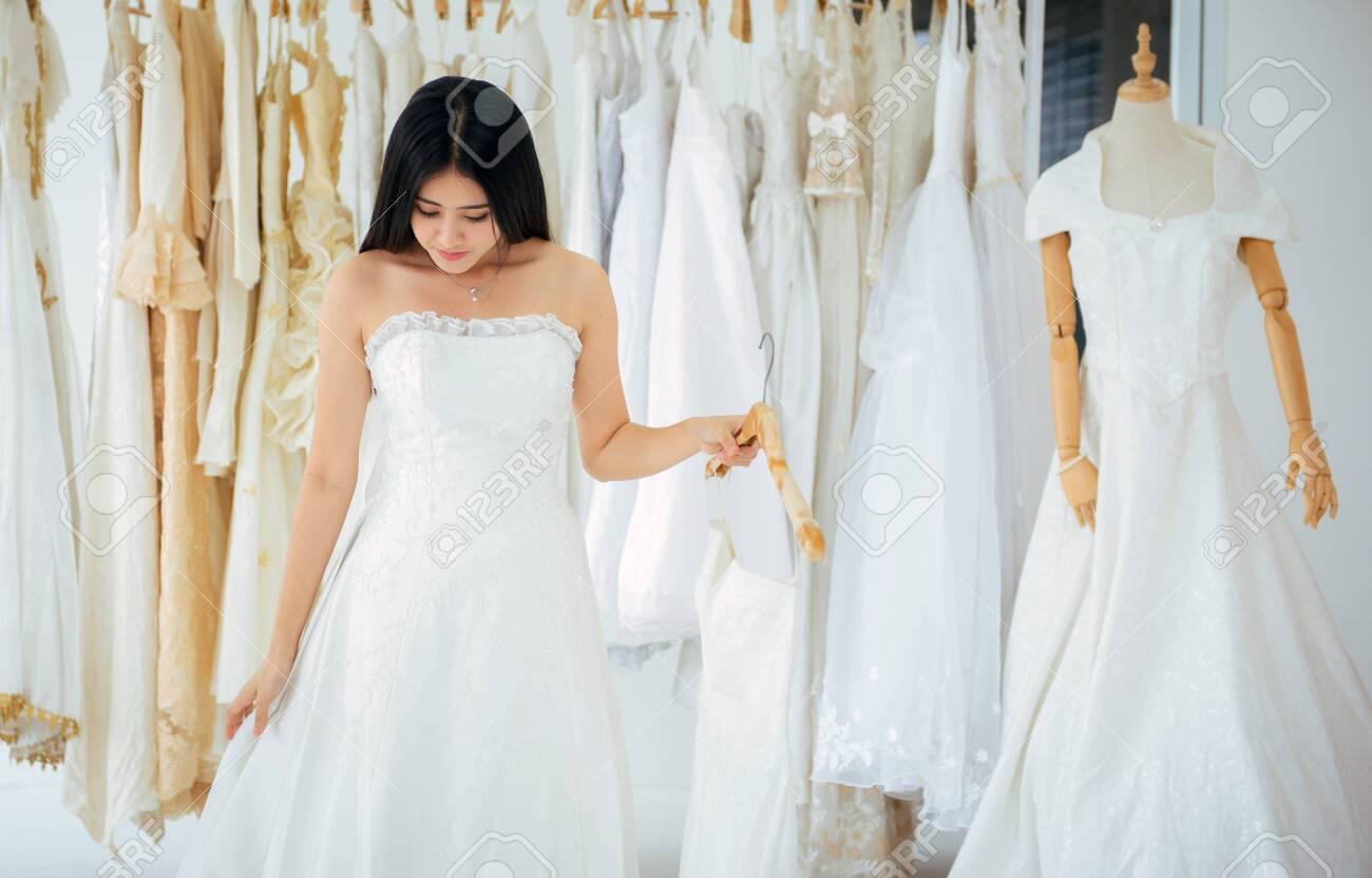 Asian Beautiful Young Women Bride Trying On Wedding Dress Happy