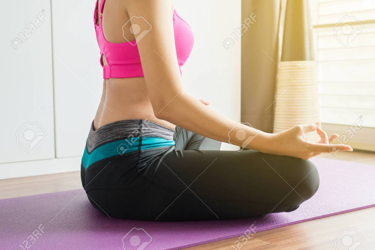 Women sitting on bed practicing doing yoga meditation, workout after waking up at home, Healthy and lifestyle concept, Close up - 128033795