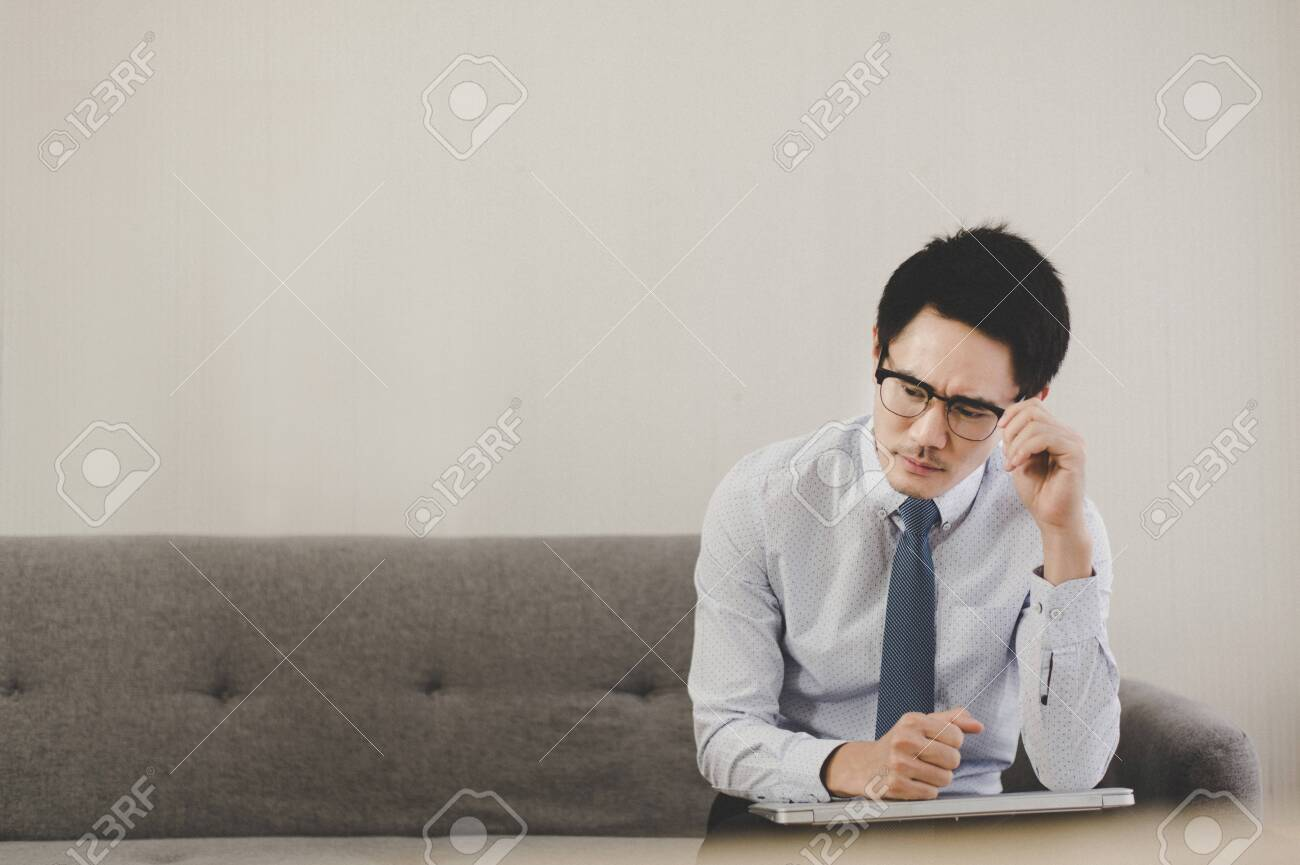 Asian man feeling so stressed and tired frustrated failure exhausted,Unemployed concept - 149806063