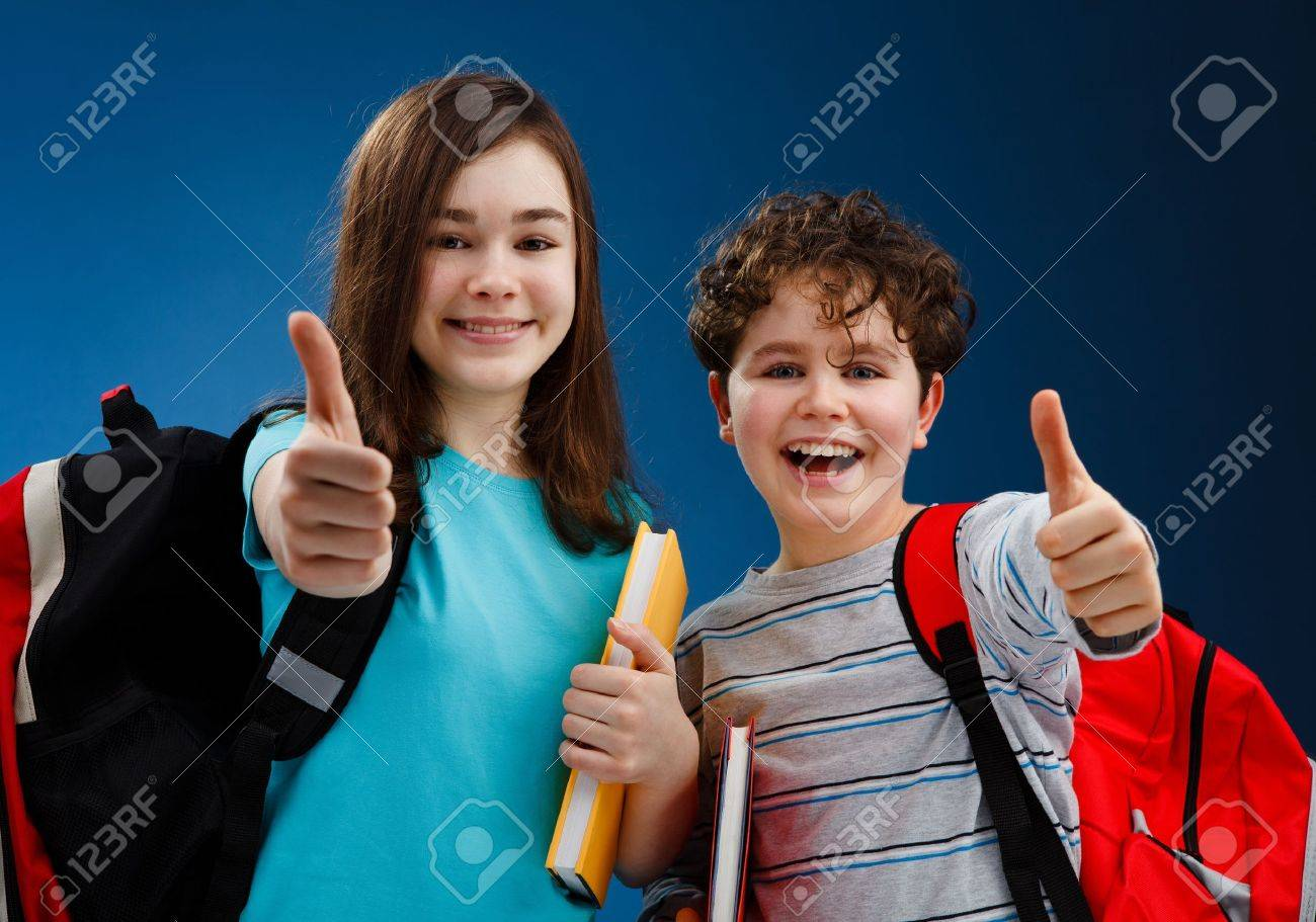 Students showing OK sign on blue background Stock Photo - 14283126