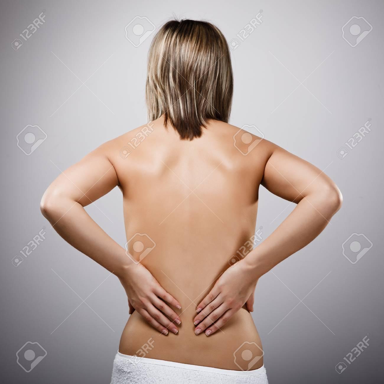 Woman massaging pain back Stock Photo - 14584097
