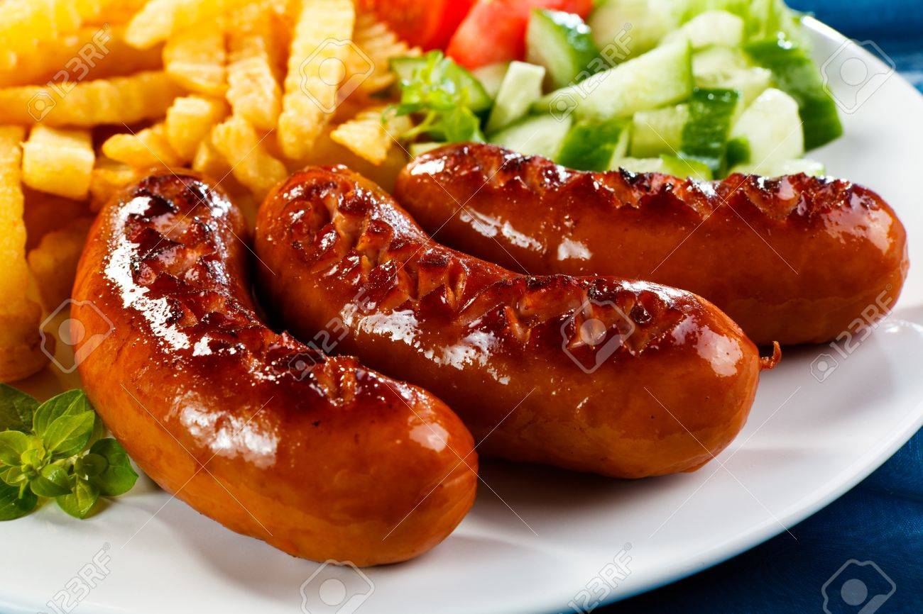 Grilled sausages, French fries and vegetables - 14632316