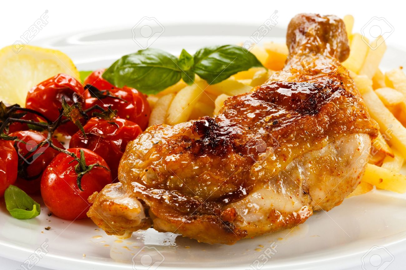 Grilled Chicken Leg, Chips And Vegetables Stock Photo, Picture And ...