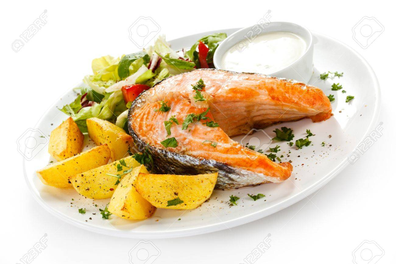 Grilled salmon, baked potatoes and vegetables Stock Photo - 17756554