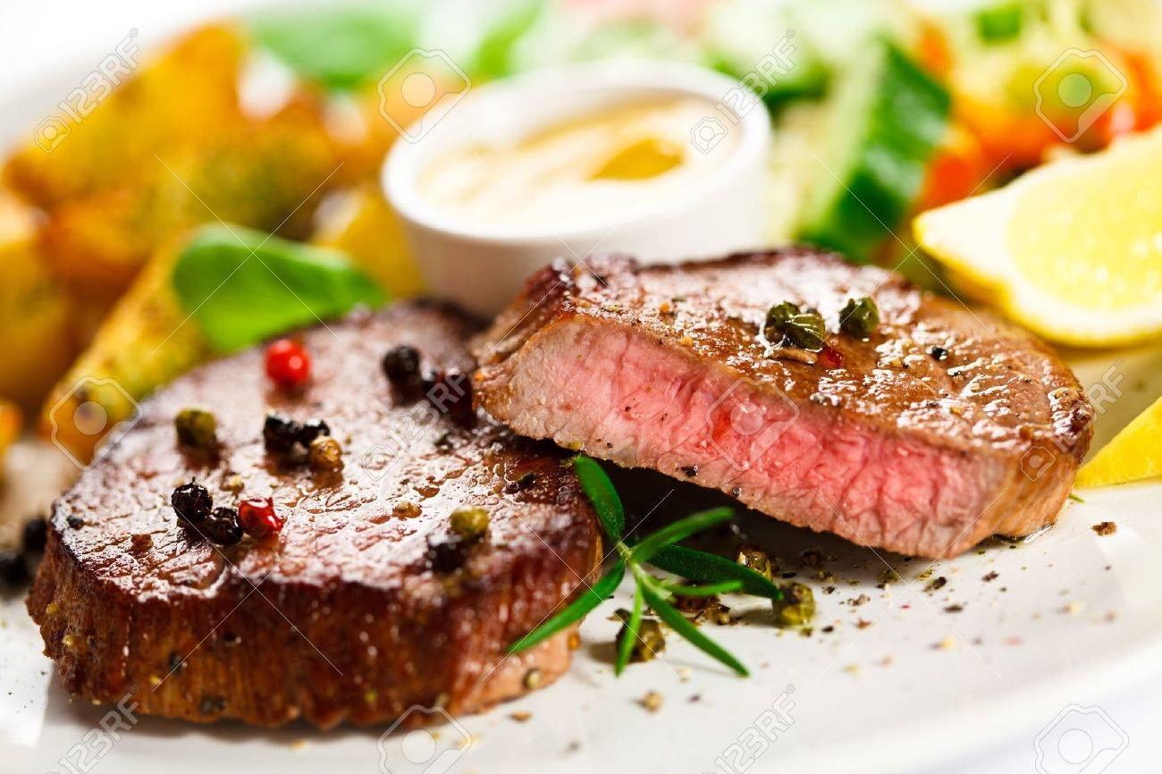 Grilled steak, baked potatoes and vegetables - 22156434