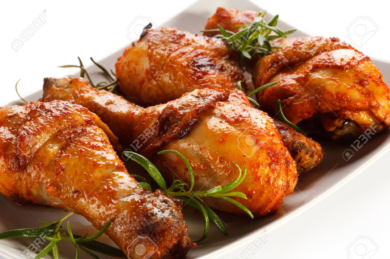 Grilled Chicken Legs On White Background Stock Photo, Picture And ...