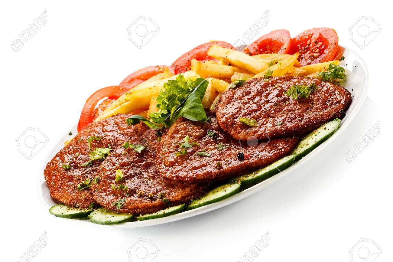 Pork chop, French fries and vegetables Stock Photo - 24155025