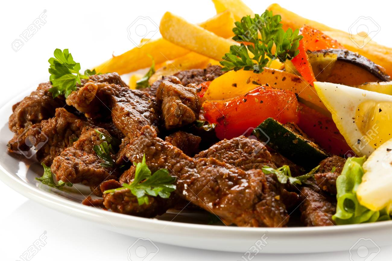 Grilled meat with French fries and vegetables Stock Photo - 24989051