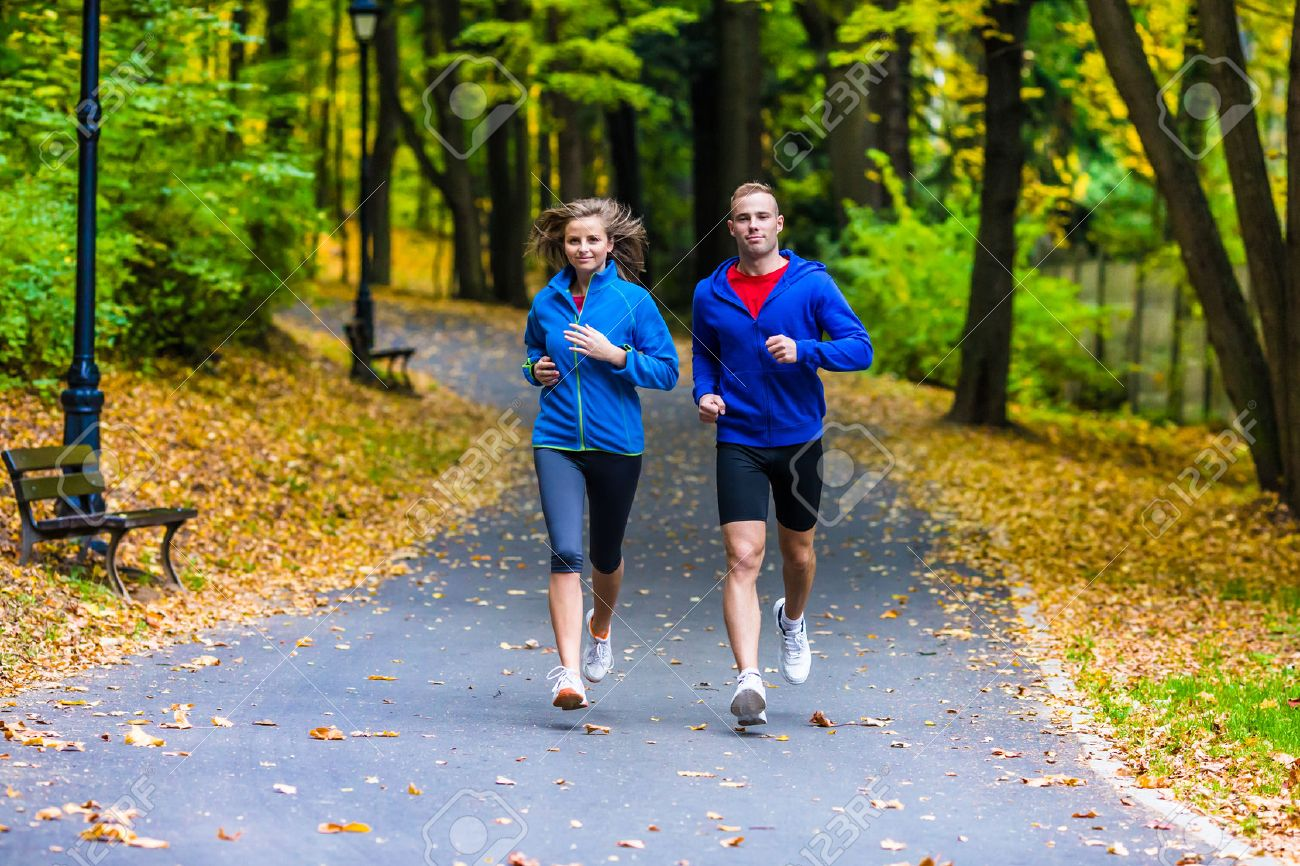 Healthy lifestyle - woman and man running Stock Photo - 45079236