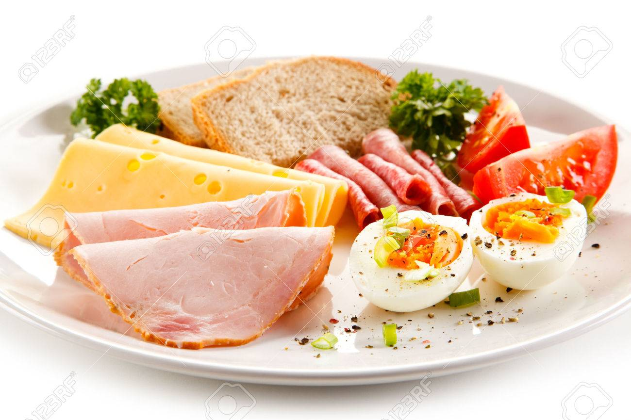Breakfast - boiled egg, ham, cheese and vegetables - 55872904