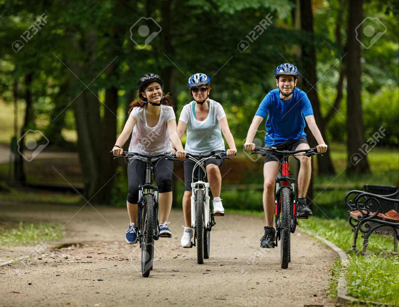 Healthy lifestyle - people riding bicycles in city park - 120572866