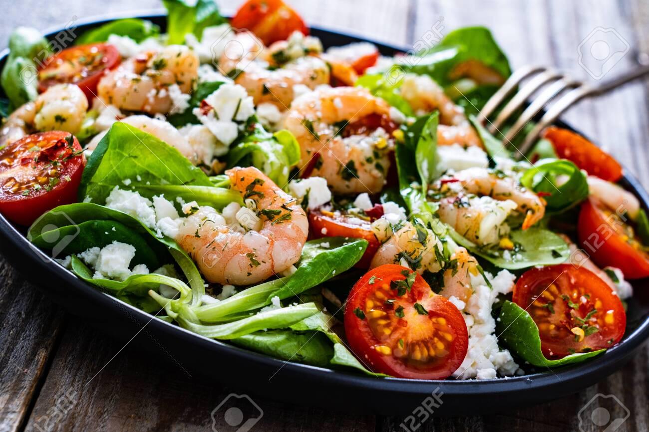Prawn salad on wooden table - 149483923