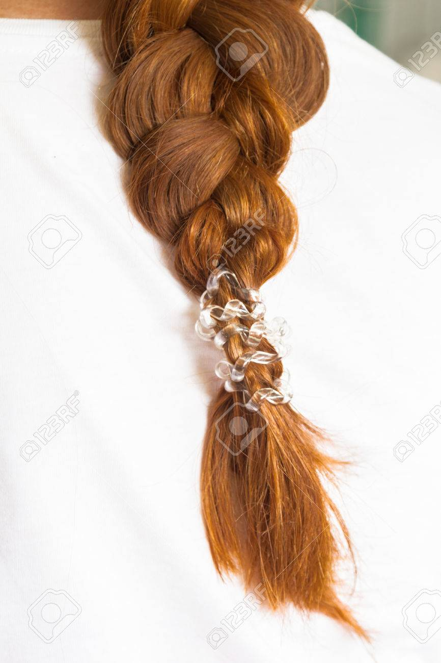 Girly Red Hair Braided Into A Braid With A Ponytail