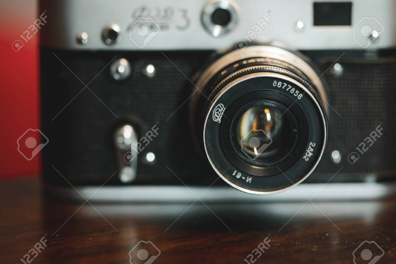 Bucharest, Romania - April 7, 2020: Details and shallow depth of field image (selective focus) with the F3 Ukrainian rangefinder vintage photo camera. - 144641654