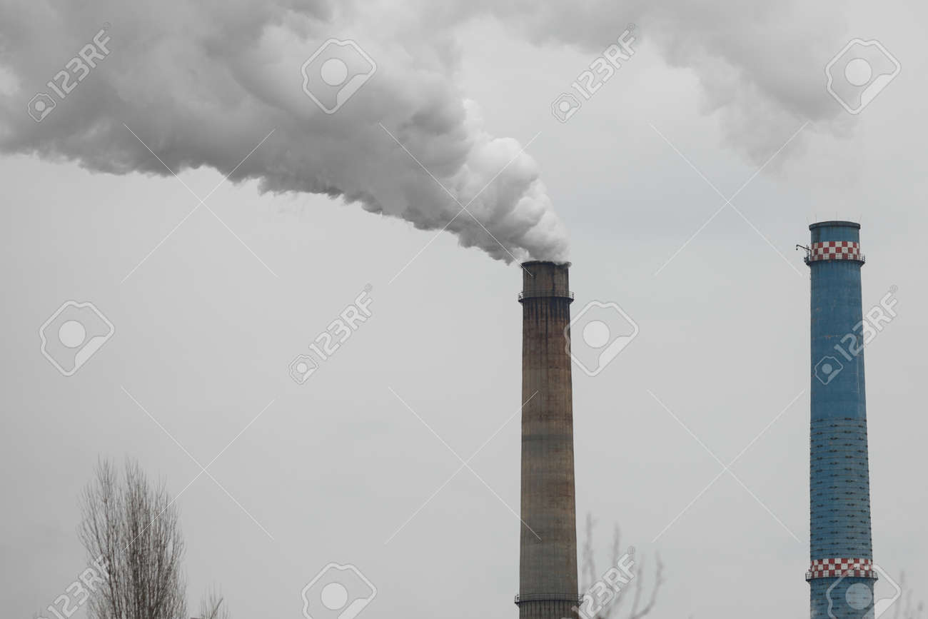 Chimney of a power station during a cold winter day in Bucharest. - 166158353
