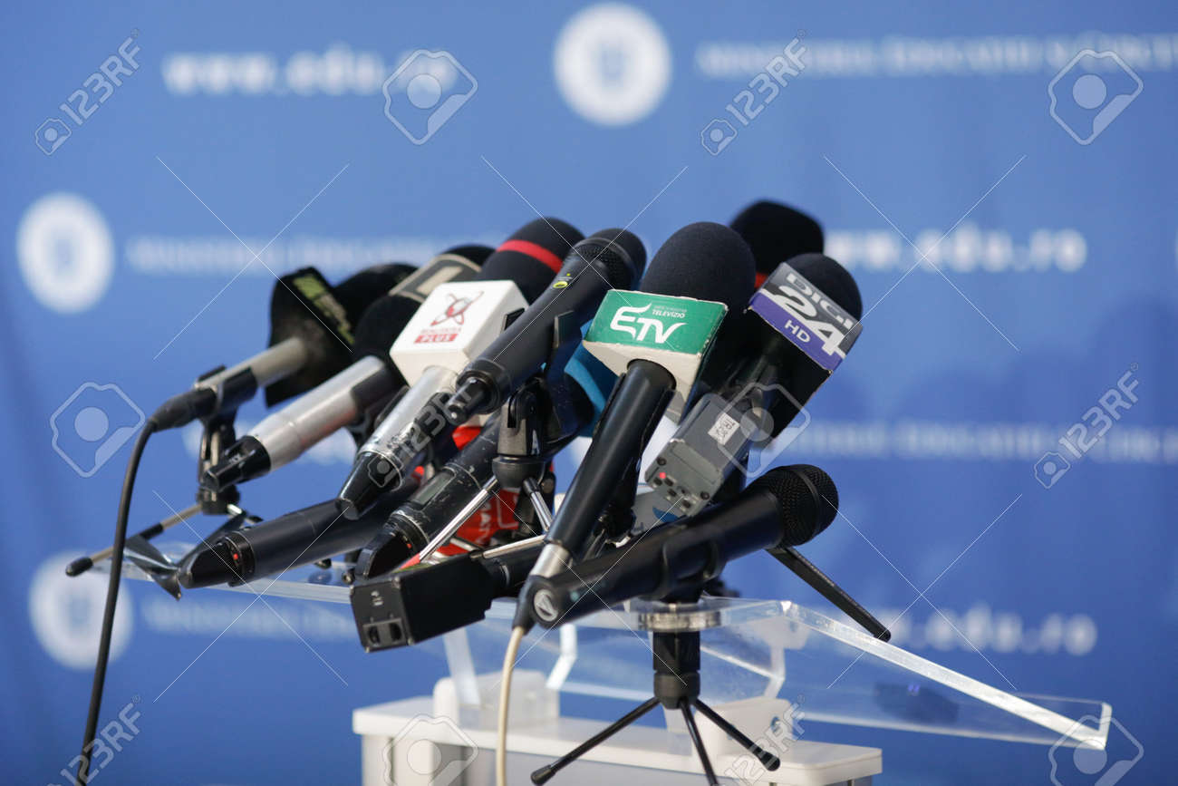 Bucharest, Romania - March 23, 2021: Shallow depth of field (selective focus) image with microphones from various Romanian news televisions before a press conference. - 166476117