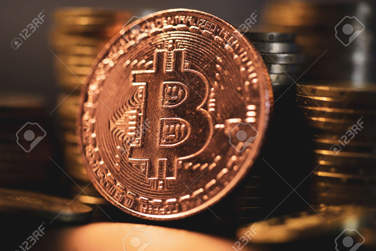 Shallow depth of field (selective focus) image with a Bitcoin metal coin near other metal coins - cryptocurrency concept. - 167104248