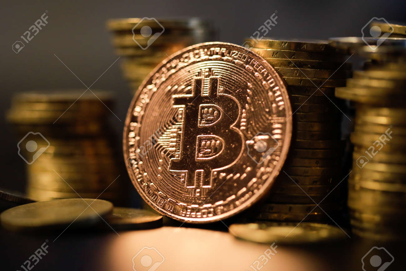 Shallow depth of field (selective focus) image with a Bitcoin metal coin near other metal coins - cryptocurrency concept. - 167104249
