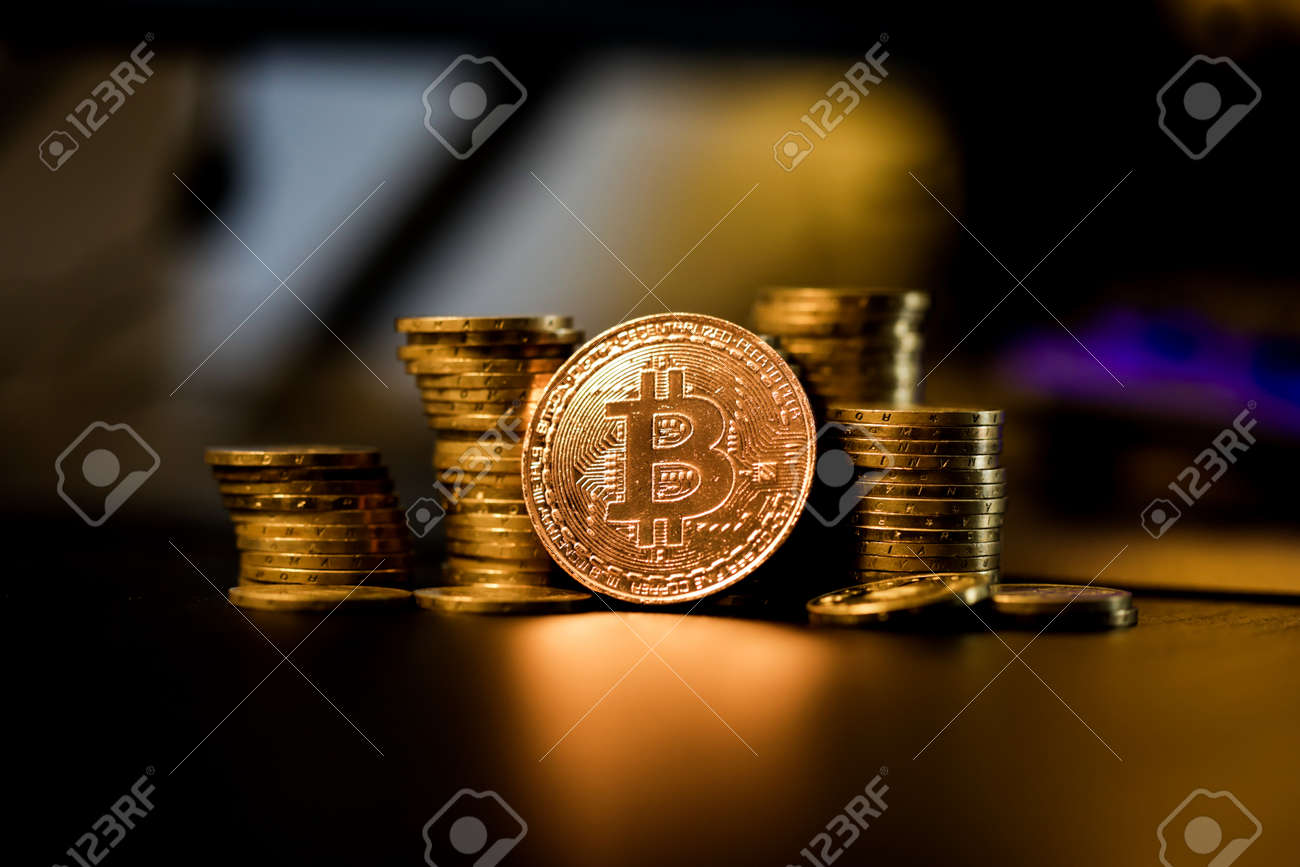 Shallow depth of field (selective focus) image with a Bitcoin metal coin near other metal coins - cryptocurrency concept. - 167104252
