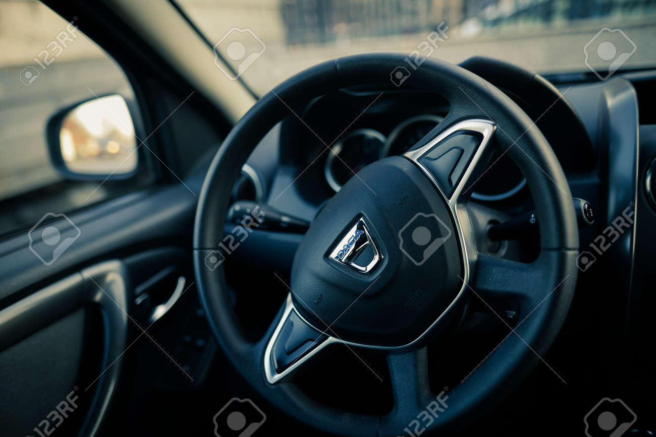 Bucharest, Romania - April 11, 2021: Shallow depth of field (selective focus) image with the Dacia logo on a Duster steering wheel. - 167598381