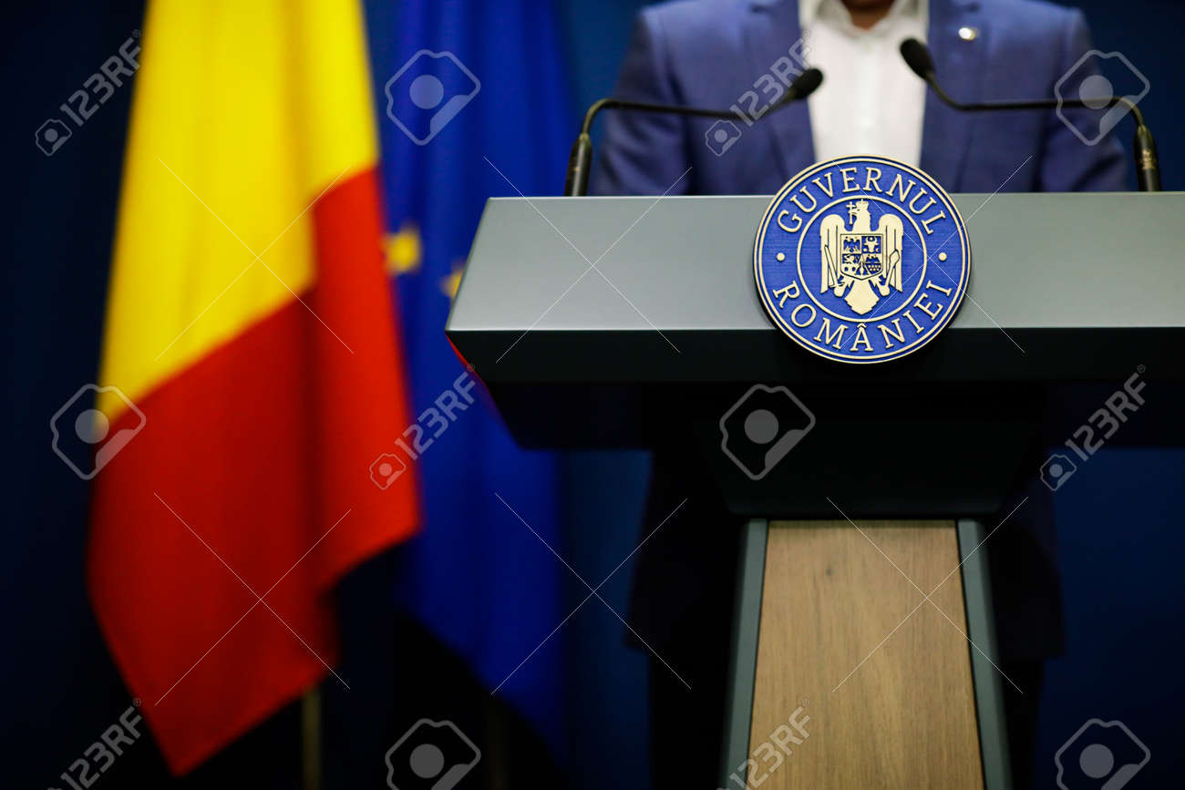 Bucharest, Romania - April 17, 2021: Details with the Romanian Government logo during a press conference held by a politician. - 167659220