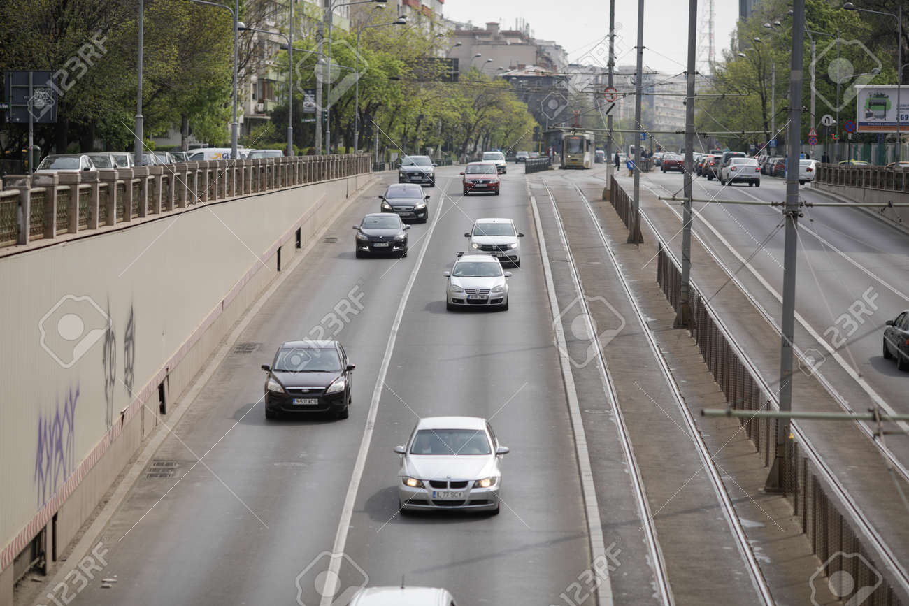 Bucharest, Romania - April 27, 2021: Cars in traffic in downtown Bucharest. - 168631296