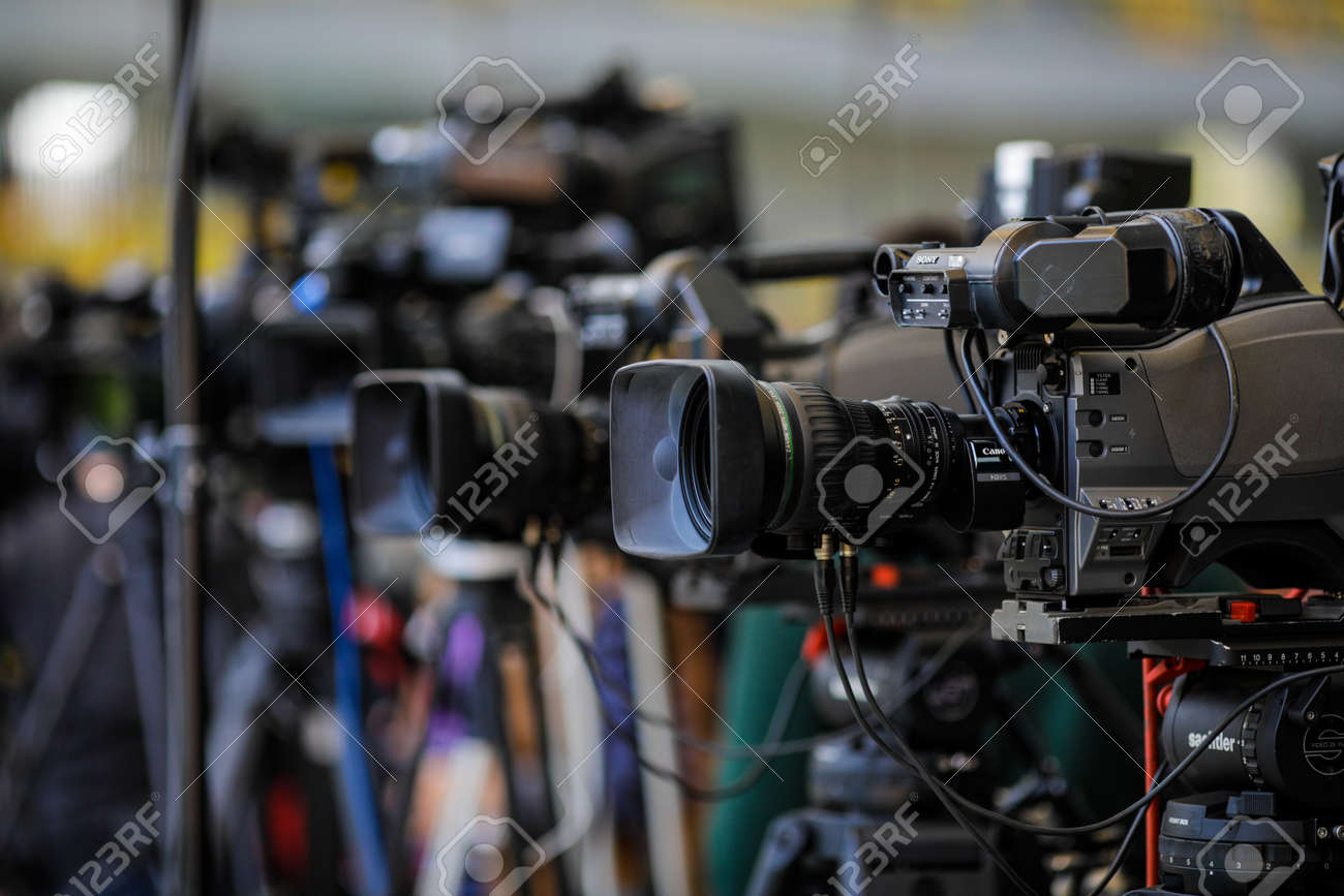 Bucharest, Romania - April 25, 2021: Shallow depth of field (selective focus) image with TV cameras on tripods on a press event. - 168631291