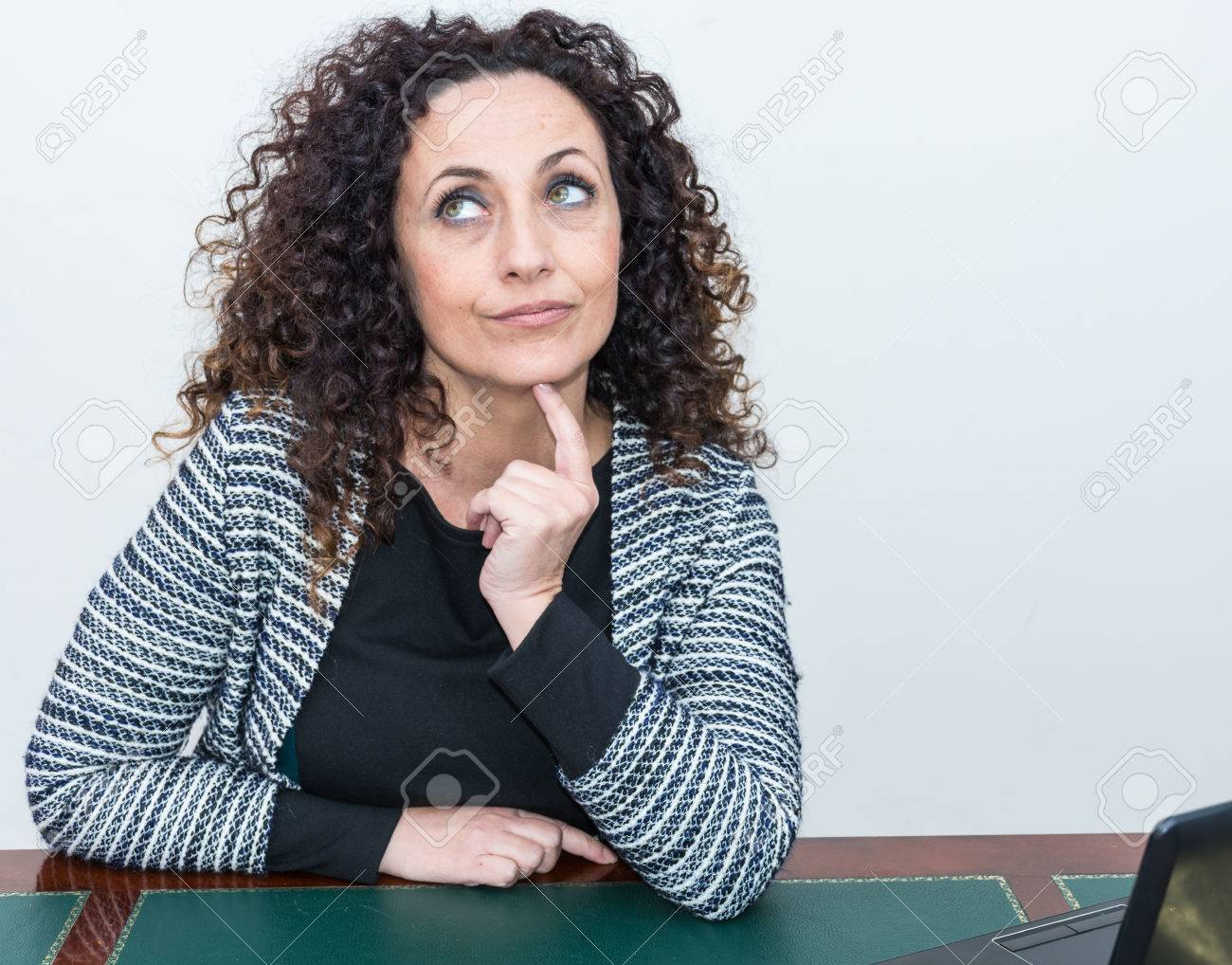Mature Woman With Pensive Eyes High With Curly Hair And Blacks And