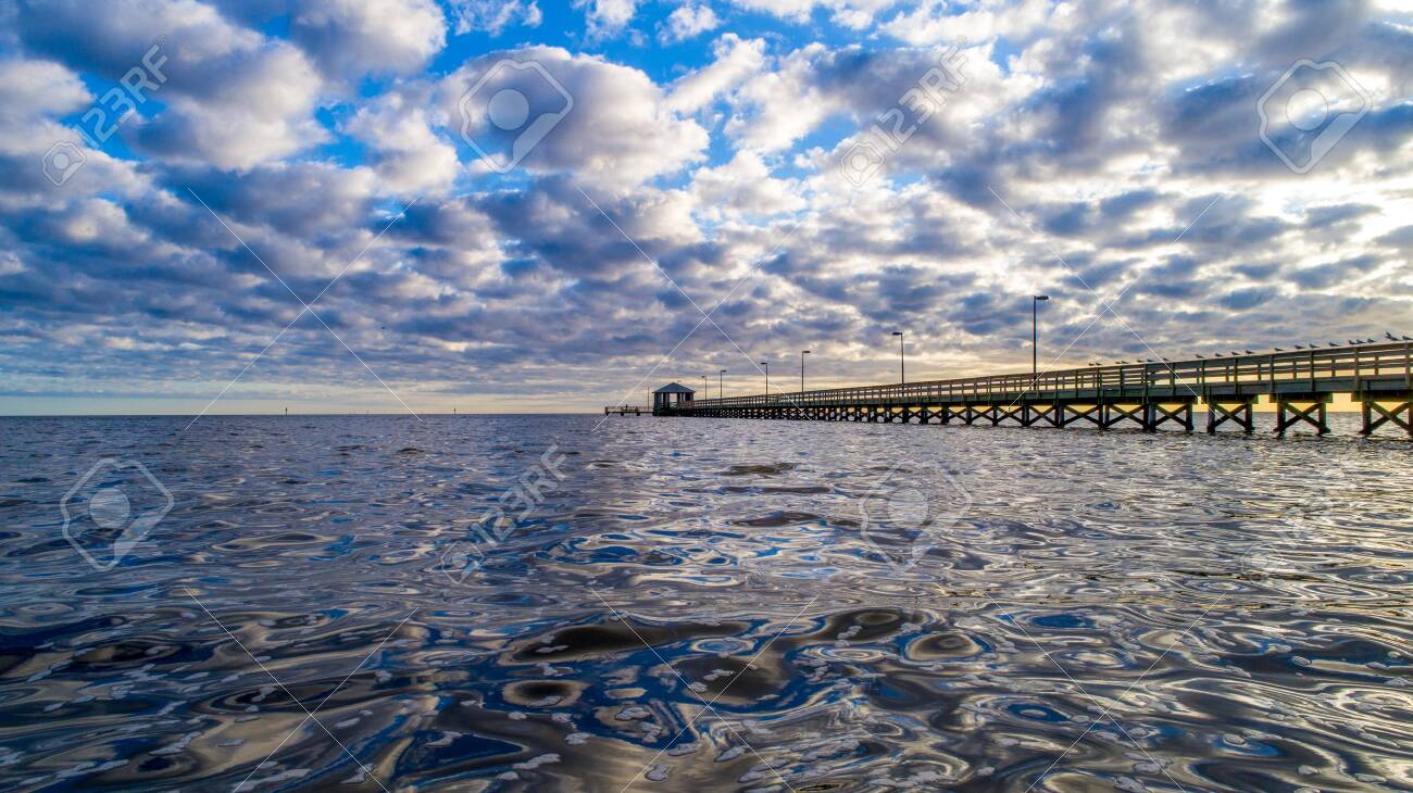 Biloxi Lighthouse Pier Stock Photo Picture And Royalty Free Image