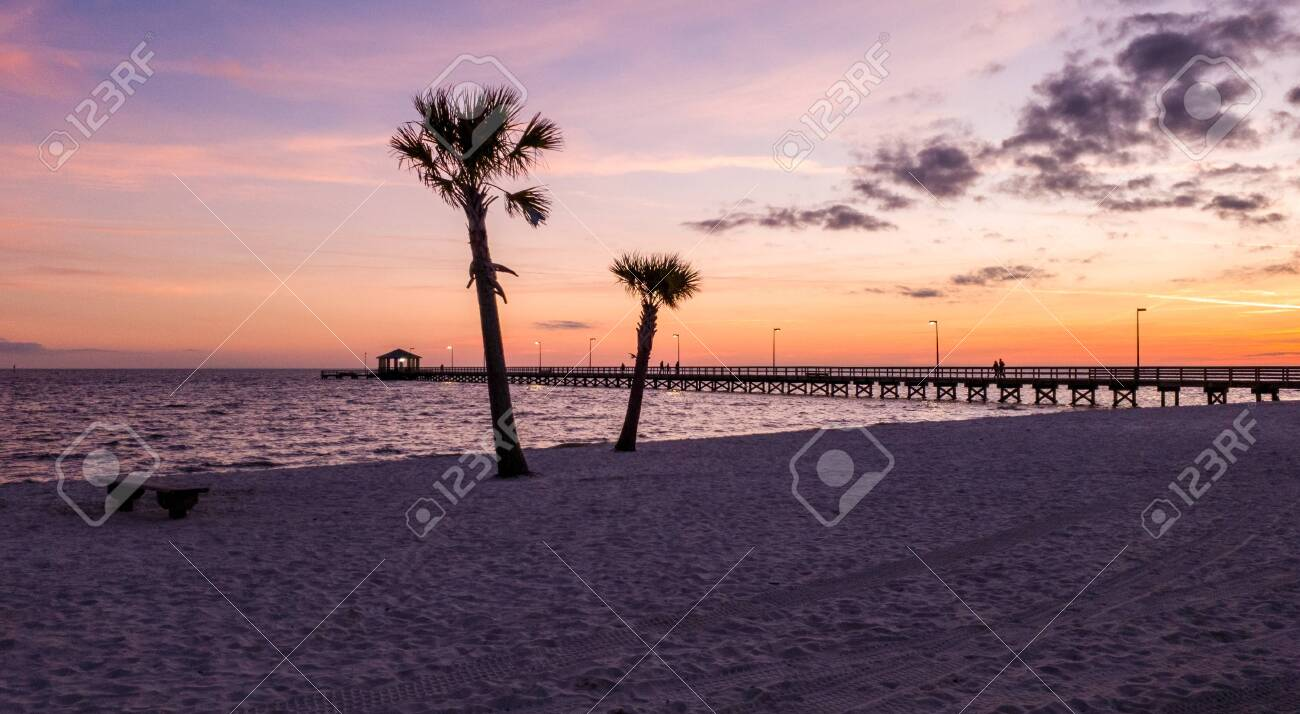 Biloxi Mississippi Beach Pier At Sunset Stock Photo Picture And