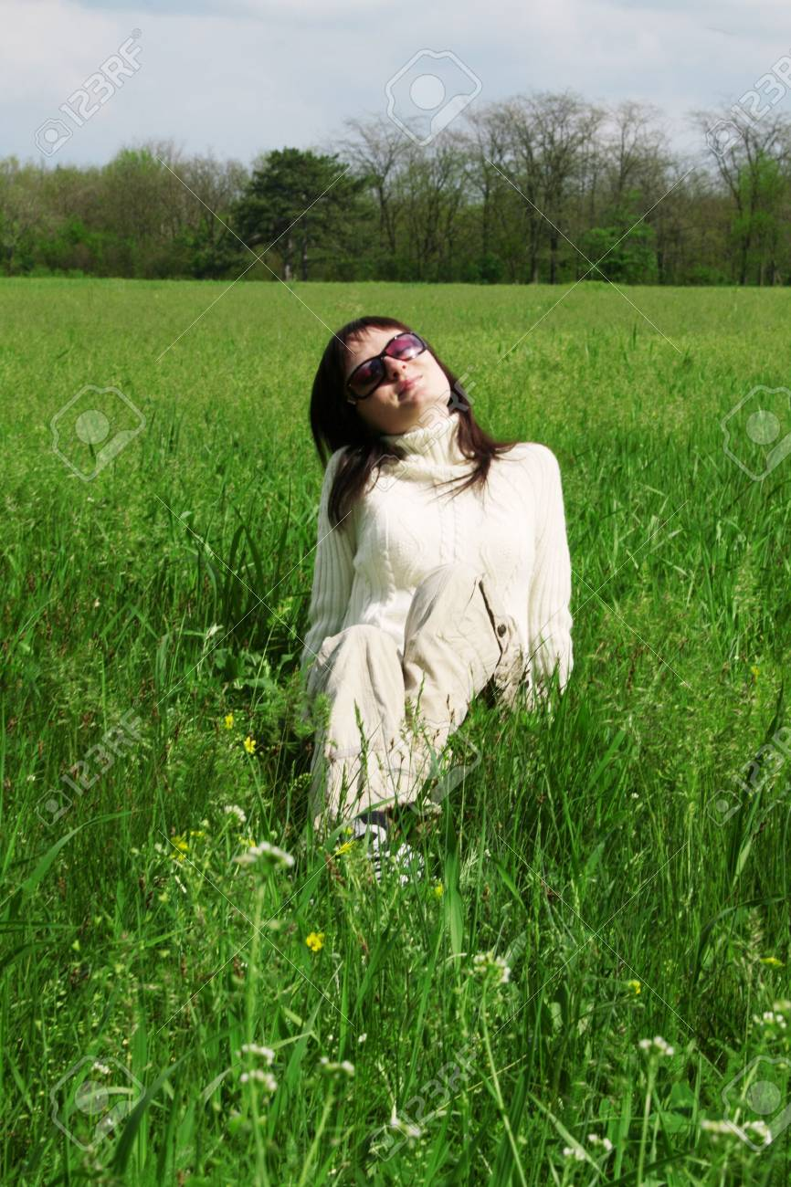Young woman enjoying a sunny day Stock Photo - 4851415