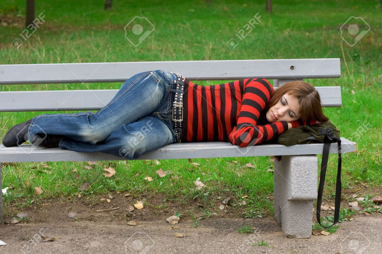 Young Girl Sleeping On A Park Bench Stock Photo Picture And Royalty