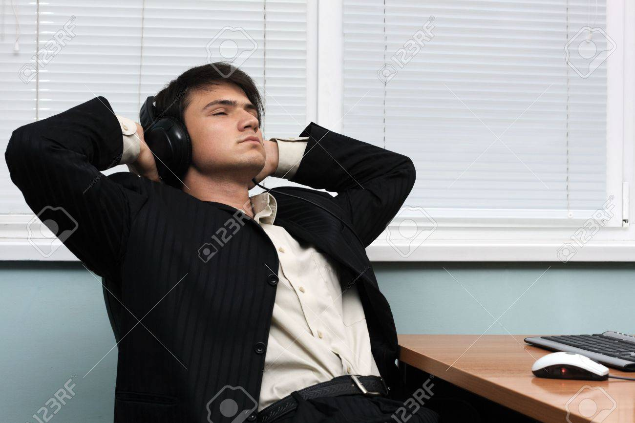Relaxed businessman having a break at his working place Stock Photo - 4851371