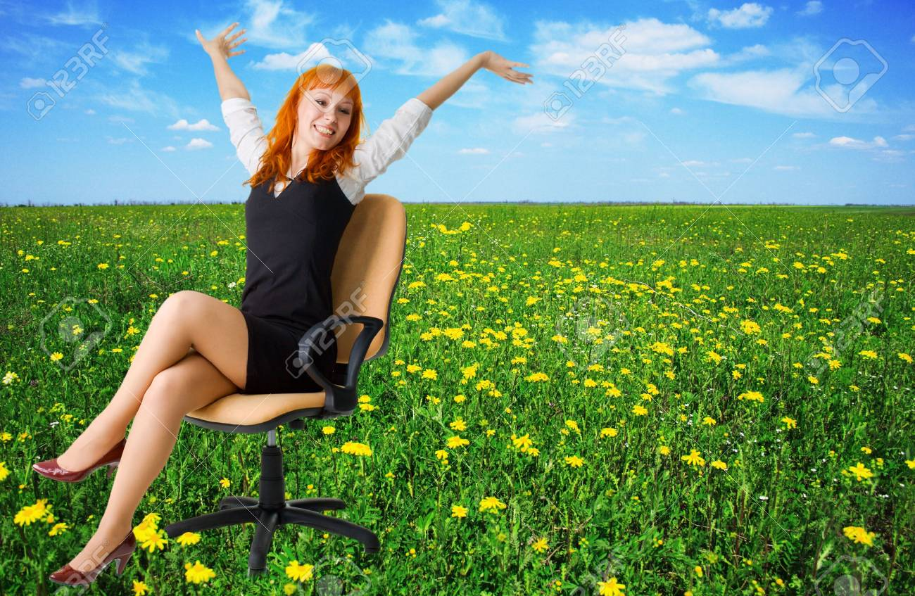 Cheerful businesswoman on a beautiful meadow full of flowers Stock Photo - 4832836