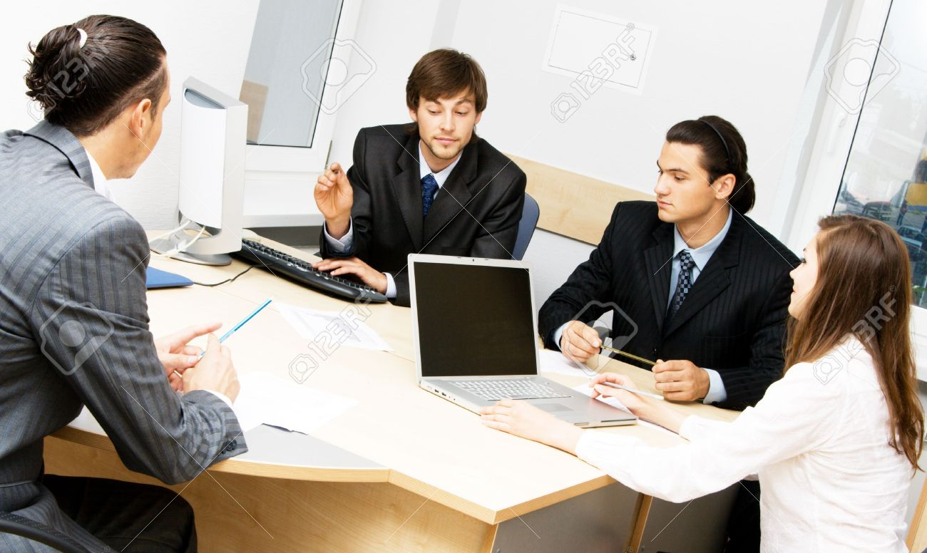 Photo of office workers having a discussion Stock Photo - 5488456