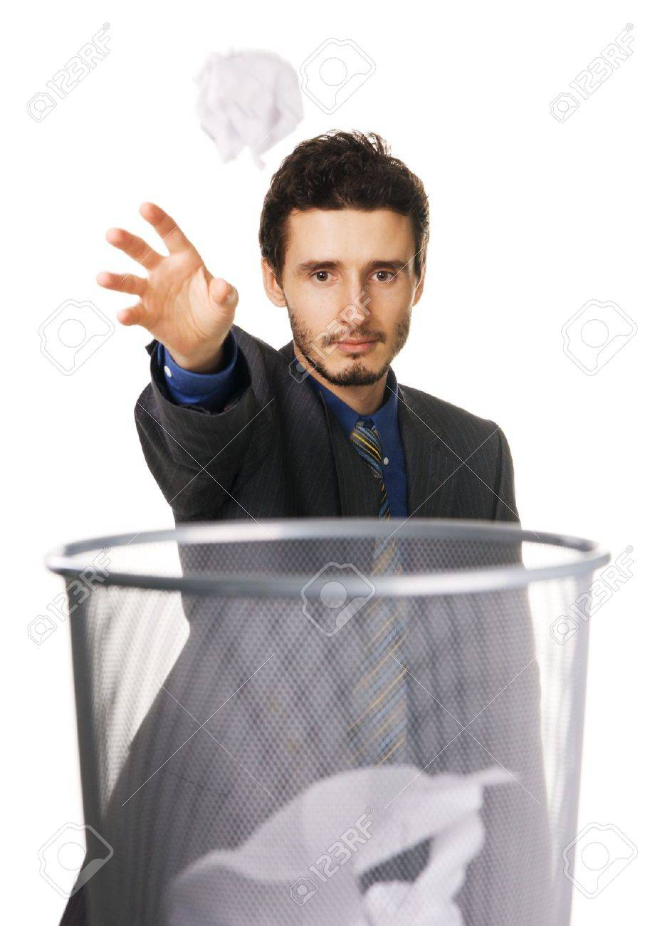 Young businessman throwing away crumpled paper, white background Stock Photo - 6322210
