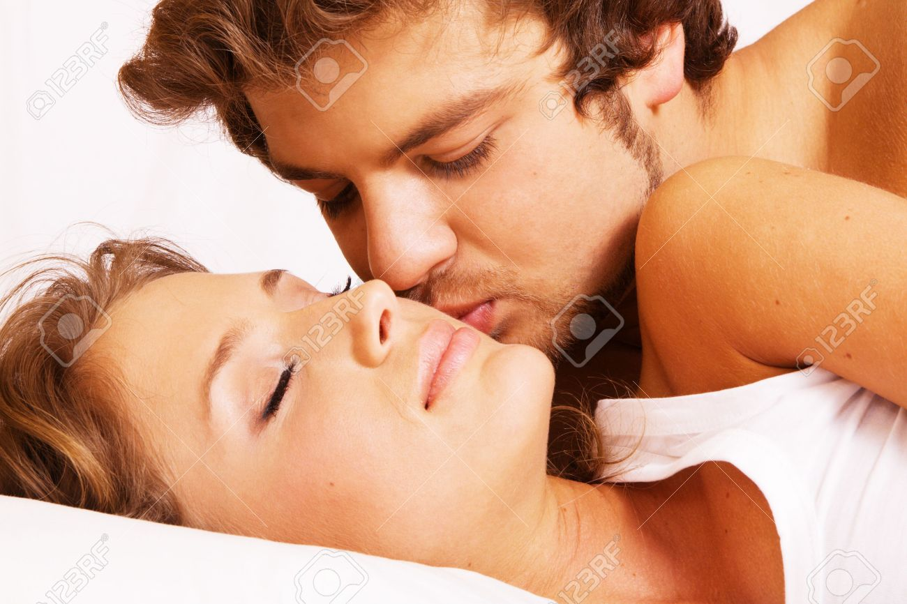 Young Beautiful Couple Sleeping In Bed Stock Photo