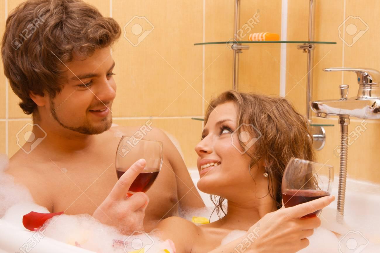 Beautiful young couple enjoying a bath with rose petals Stock Photo - 7012821