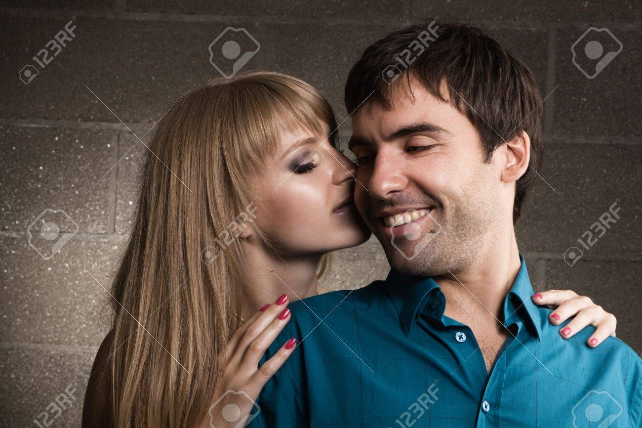 Young romantic couple kissing in house interior Stock Photo - 7143232