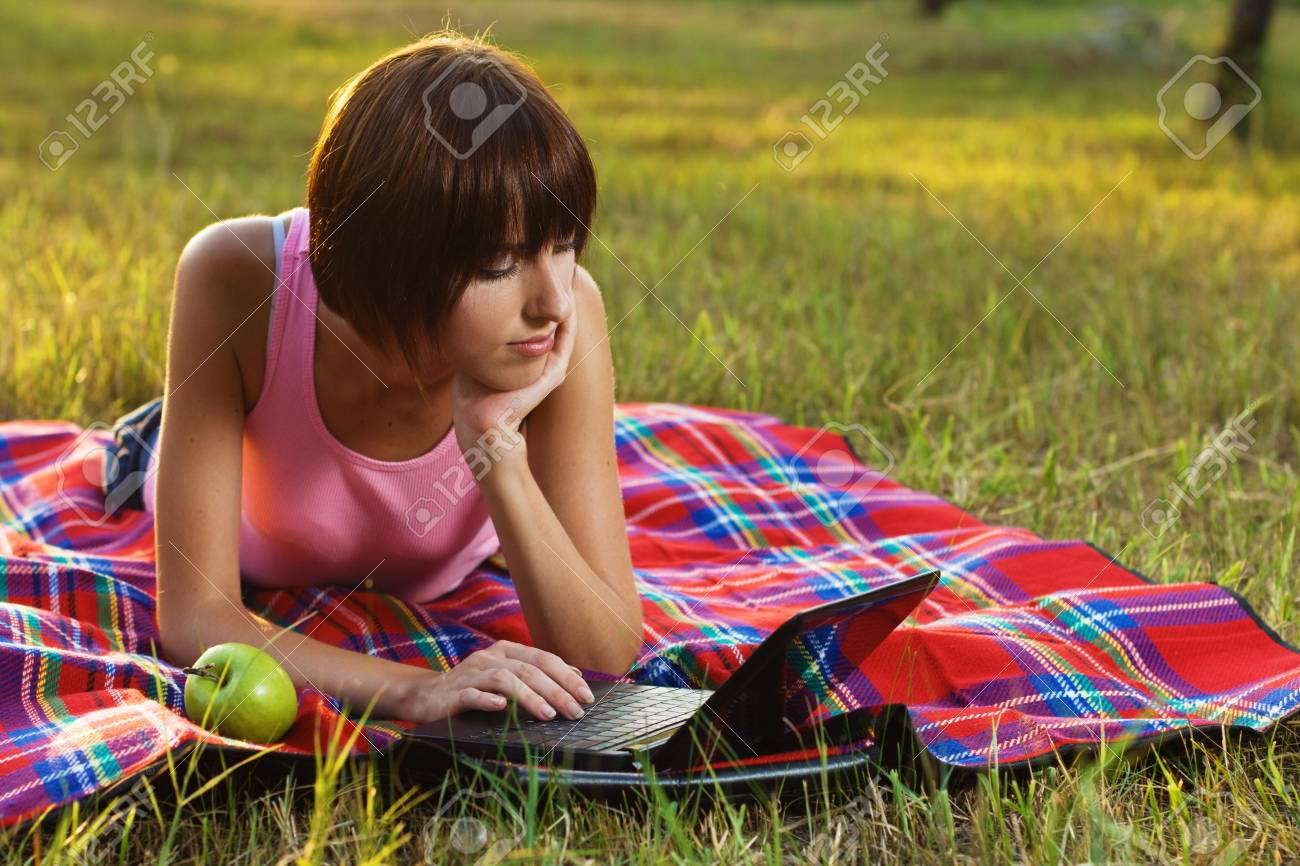 Lovely girl having a rest with laptop on picnic Stock Photo - 7805817