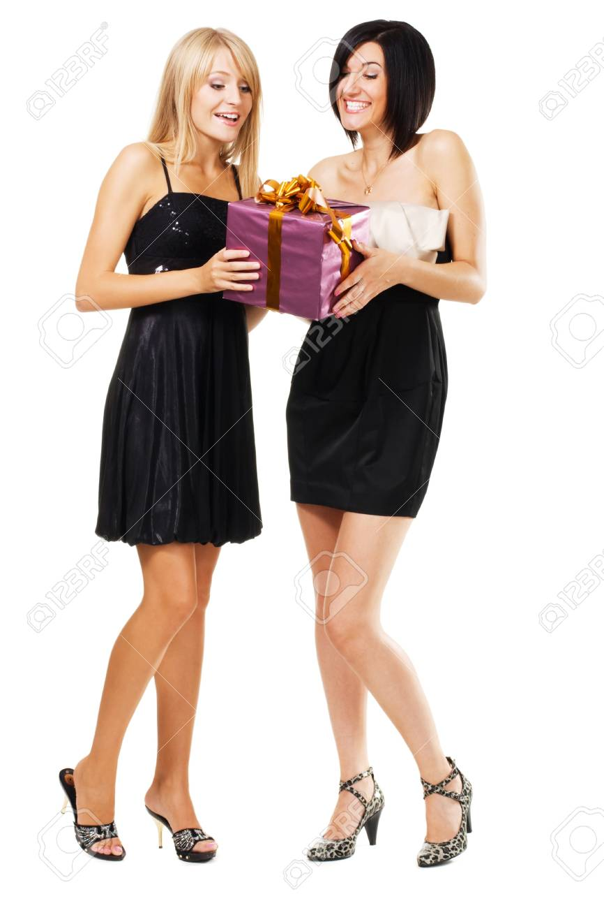 Pretty festive girls with a gift box, isolated on white Stock Photo - 7849859