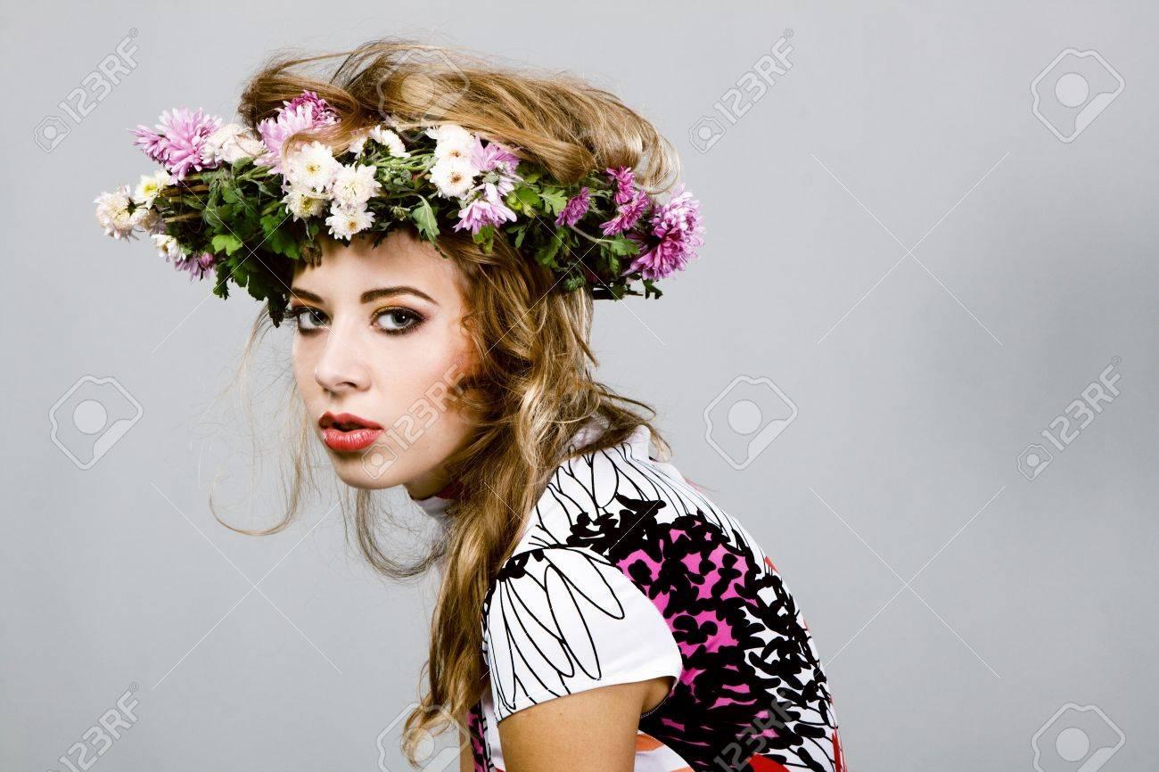 Portrait Of A Beautiful Fashion Model In Flower Crown Stock Photo