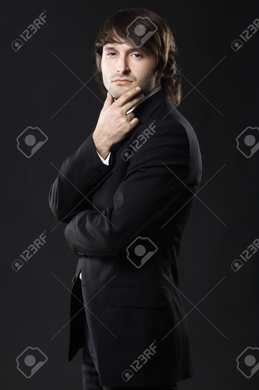 Portrait of a cool man against black background Stock Photo - 8653422