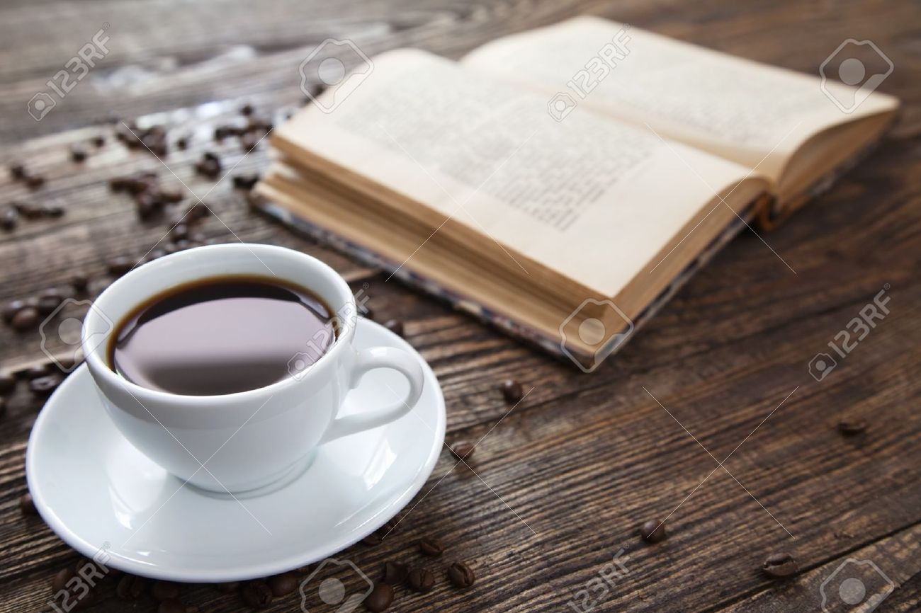 cup of coffee on a wooden table stock photo, picture and royalty