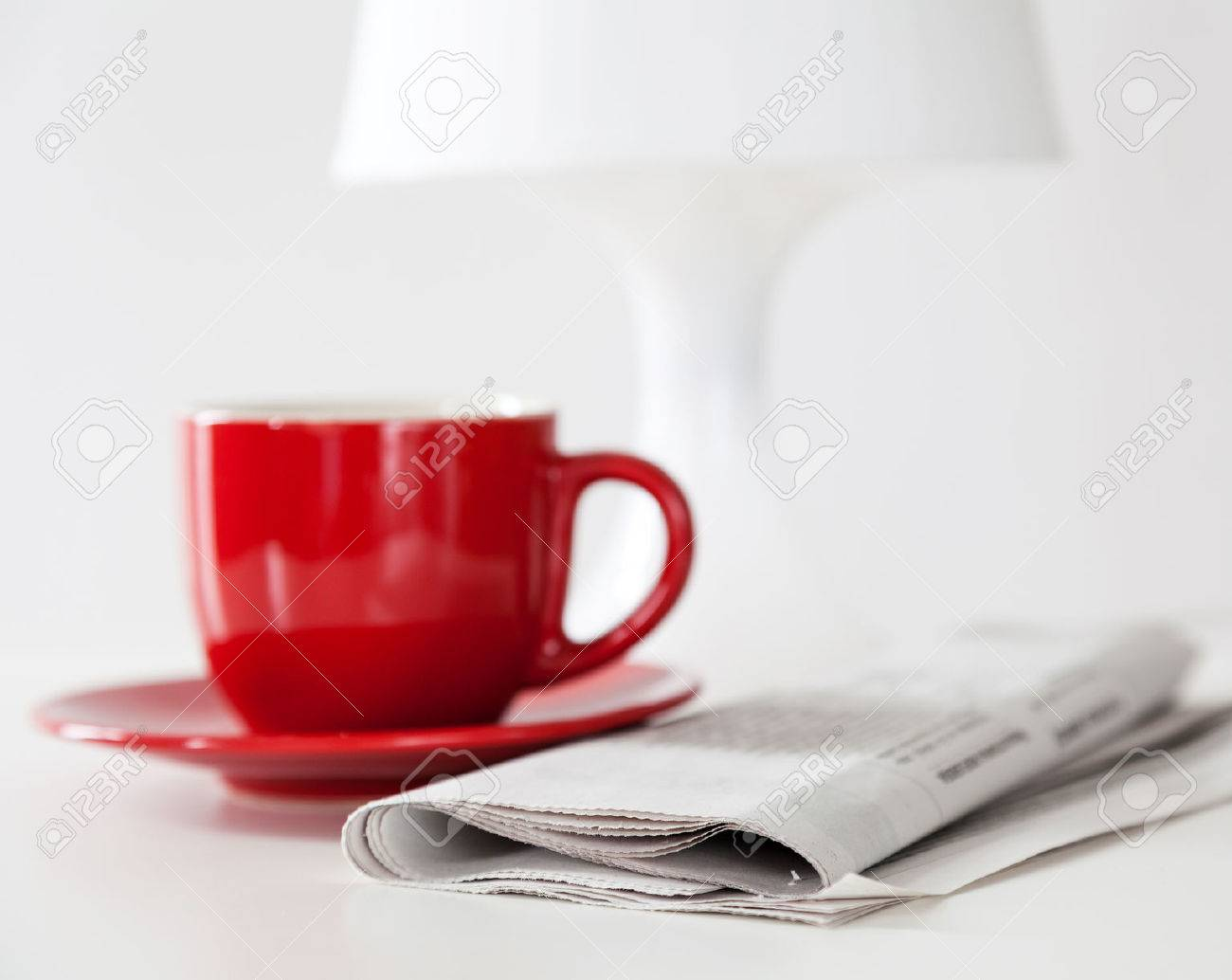Newspaper and a coffee cup on a white table Stock Photo - 23824858